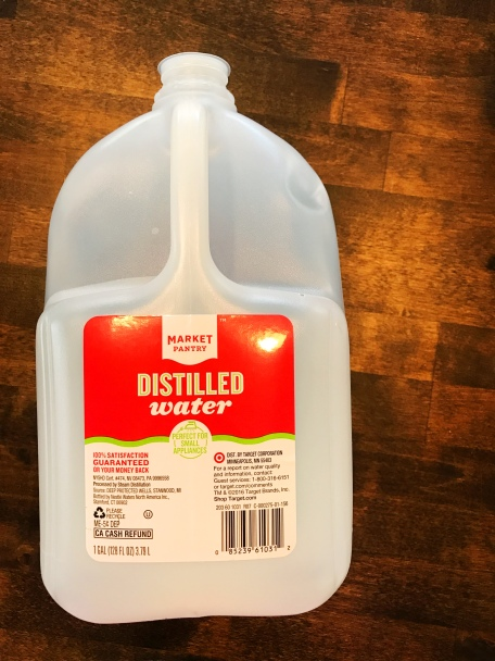 Distilled water from Target being used as an ingredient in a freshening spray for dogs.
